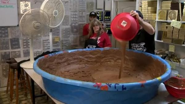 Watch the video Candy shop attempts world record for largest peanut butter cup on Yahoo News . The Candy Factory in North Hollywood pours hundreds of pounds worth of melted chocolate into a kiddie pool, in hopes of making the world's largest peanut butter cup. Vanessa Johnston reports.