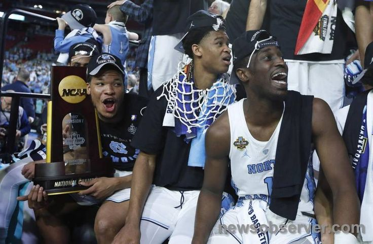 "From left, North Carolina's Kennedy Meeks (3), Isaiah Hicks (4) and Theo Pinson (1) watch ""One Shining Moment"" after UNC's victory over Gonzaga in the NCAA Division I men's basketball national championship game at the University of Phoenix Stadium in Glendale, AZ, Monday, April 3, 2017."