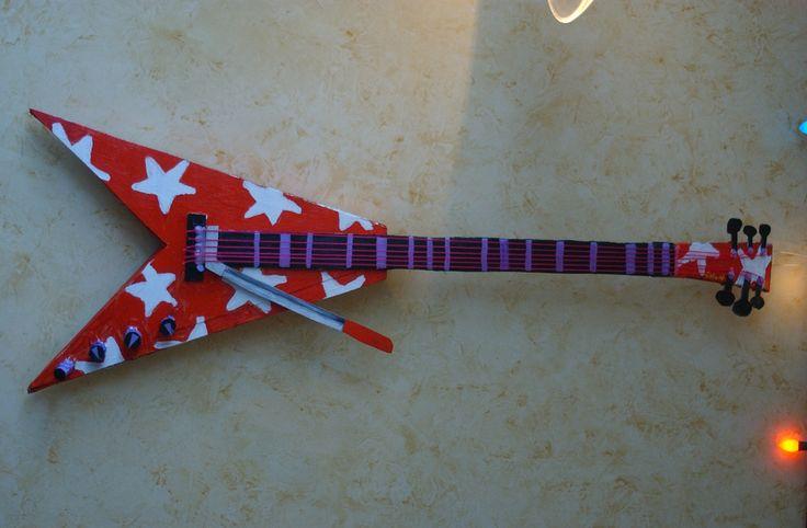 V guitar cardboard and acrylic $450