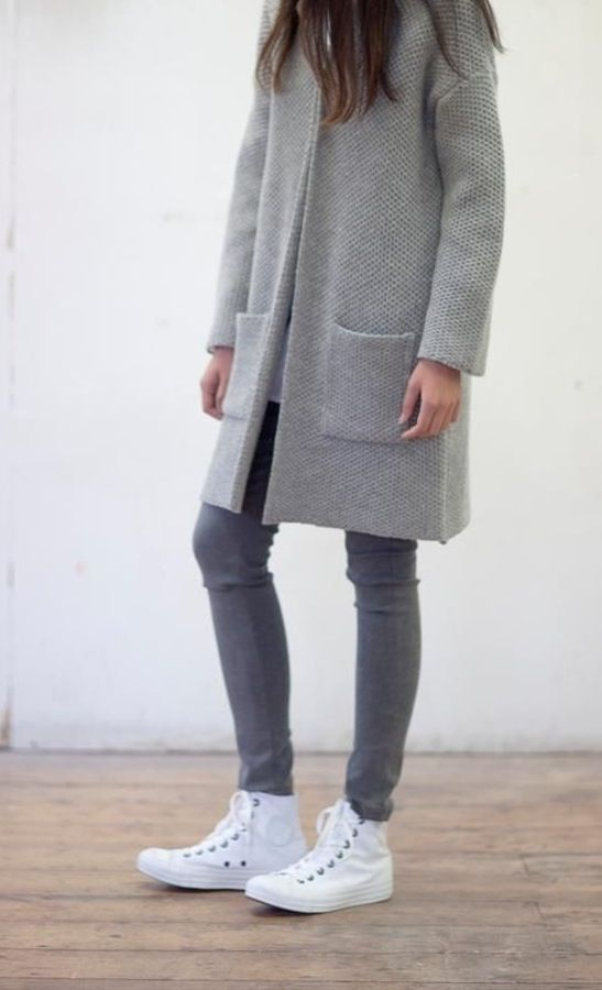 Rock a grey coat with grey slim jeans for a Sunday lunch with friends. Mix things up by wearing white canvas high top sneakers.   Shop this look on Lookastic: https://lookastic.com/women/looks/grey-coat-grey-skinny-jeans-white-canvas-high-top-sneakers/16324   — Grey Coat  — Grey Skinny Jeans  — White Canvas High Top Sneakers