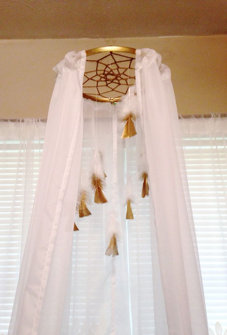 Dream catcher mobile/canopy. Gold dipped feathers.