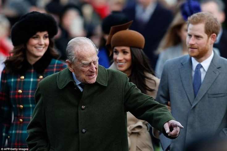 Prince Philip, Duke of Edinburgh gestures as he is followed by the Duchess of Cambridge, M...
