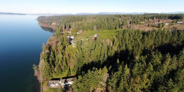 Fabulous view from this high bank waterfront lot on 4.49 acres in Kayak Cove. Watch boats, eagles, seals and whales. Expansive views of Whidbey Island and the Olympic Range. Level building site with plenty of the prep work complete. Stones throw to Kayak Point Beach Park and boat launch. beautiful, natural foliage and evergreens, all utilities at building site, close to Kayak Golf course paved street. Waiting for your custom home!