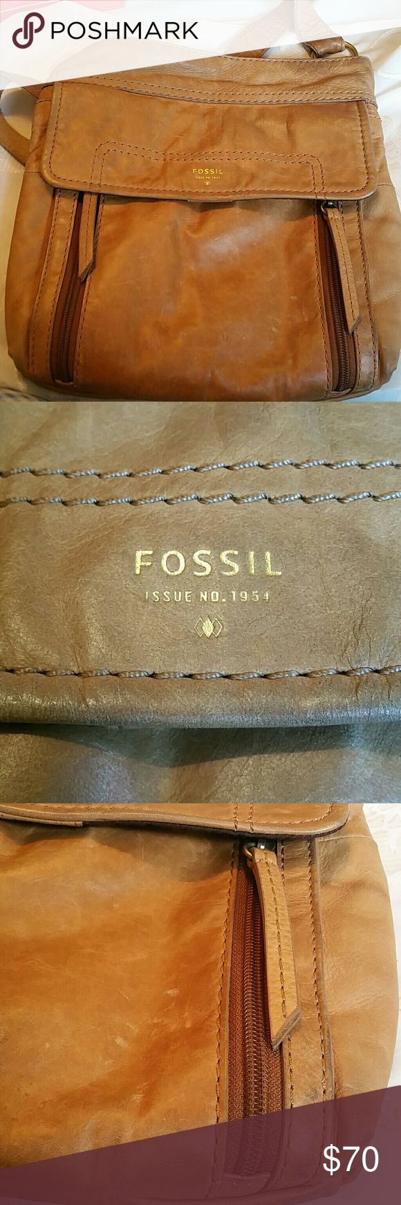 Fossil leather Crossbody This baby has 8 pockets. About 12 inches high, 10 inches wide. Purchased at Navy Exchange Virginia Beach. This is a sentimental item. My sister picked it out. I only used it for 2 months and it's been in storage. Inside the main body is some time of residue. And inside the outside pocket is where my niece put her gum. It needs iced and removed. There is visible wear on the strap. Despite it all this bag has lots of life left. Price reflects condition. Fossil Bags…