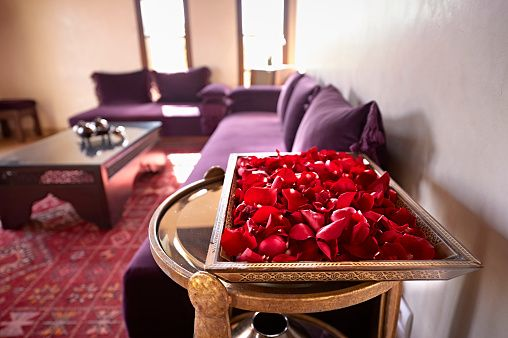 Morocco, Fes, tray of red rose petals in a suite of Hotel Riad Fes