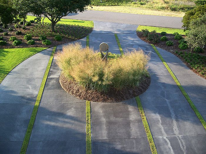 I love how the circular bed brings a sense of flow and motion to the  landscape. By Classic Landscapes in Wilmington, NC. - 11 Best Driveway Landscapes Images On Pinterest Driveways