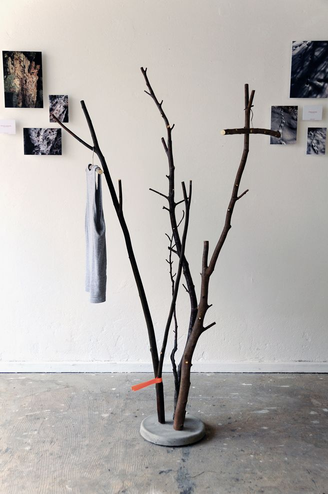 DIY Concrete Branch Coat Rack - A bucket of wet concrete, a couple of branches and let it dry.