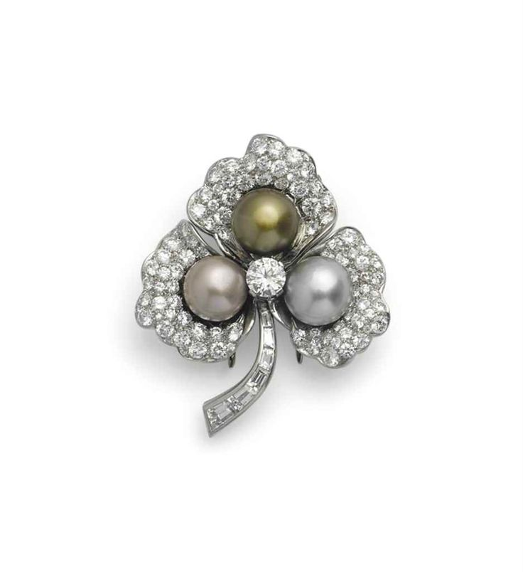 On sale November 15th at Christie's in Geneva  a_coloured_natural_pearl_and_diamond_brooch_by_bulgari_d6029540g