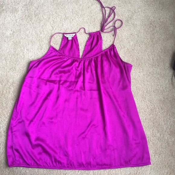 American eagle purple silky feel top size XL American eagle outfitters silky feel top size XL. 100% polyester. Shown with dalia collection black lace skirt and Jcrew clutch. Bundle and save! American Eagle Outfitters Tops Blouses