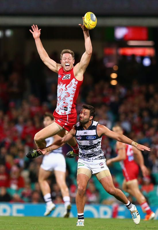 Jeremy Laidler of the Swans leaps over Jimmy Bartel of the Cats during the round 11 AFL match between the Sydney Swans and the Geelong Cats at the Sydney Cricket Ground on May 29, 2014 in Sydney, Australia.