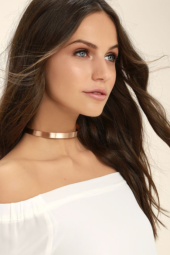 "The Dearly Beloved Rose Gold Choker Necklace has been gathered here today to give you impeccable style! Flexible, matte rose gold metal forms this minimalist choker. Necklace measures 12"" around with a 4"" extender chain."