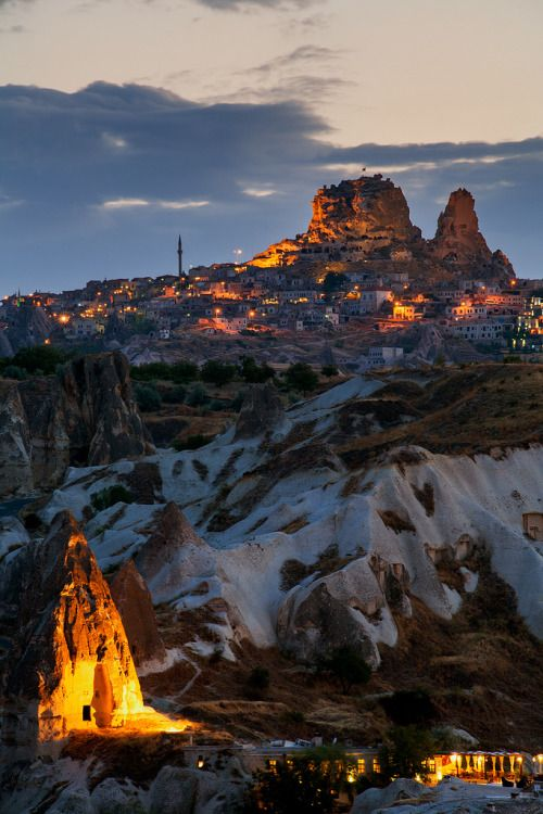 """Fairy Tale Homes"" by Jonathan Reid. The Town of Goreme lies within the ""fairy Chimney"" rock formations in Cappadocia, turkey."