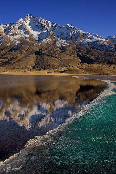 Pakistan - Shandur Lake is located in the District Gilgit Baltistan of Pakistan in high mountain pass connects to Chitral and Gilgit