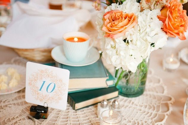 Aqua & Orange vintage centerpiece.  I really like how they used the books to bring in the blues.
