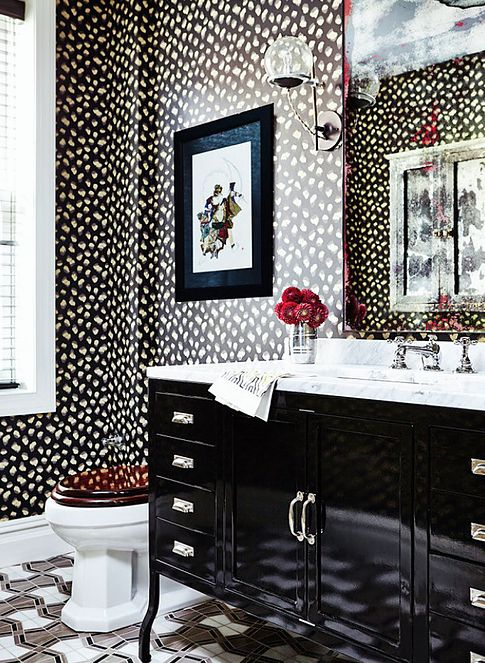 KELLY WEARSTLER | FELINE WALLPAPER IN EBONY IVORY. An updated version on a classic animal print, with abstract lkat undertones and vivid colors.