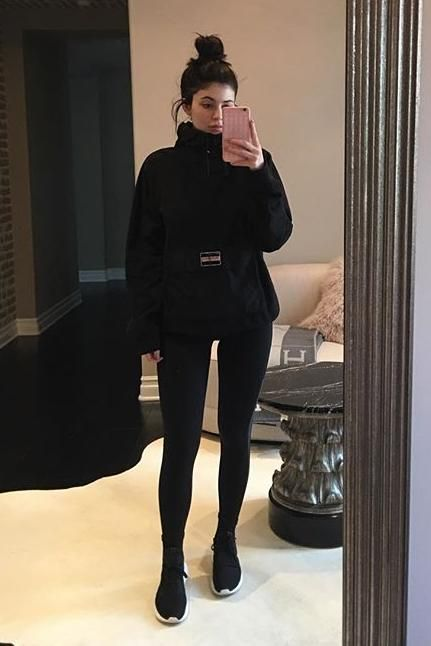 Kylie Jenner wearing Ovo 1-800-Hotlinebling Iphone Case, Adidas Tubular Defiant Sneakers in Core Black/Core White and Supreme Fleece Pullover
