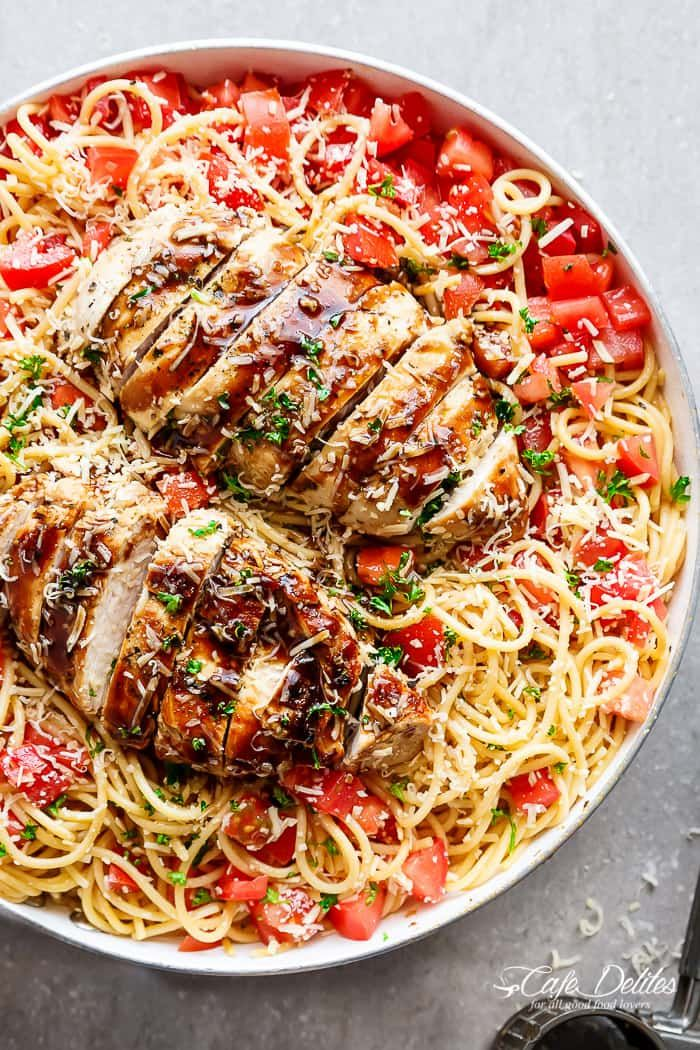 Bruschetta Chicken Pasta Salad is a must make for any occasion in minutes! Filled with Italian seasoned grilled chicken, garlic and parmesan cheese!