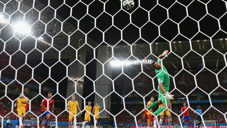 Jorge Valdivia of Chile shoots and scores his teams second goal against goalkeeper Mathew Ryan of Australia