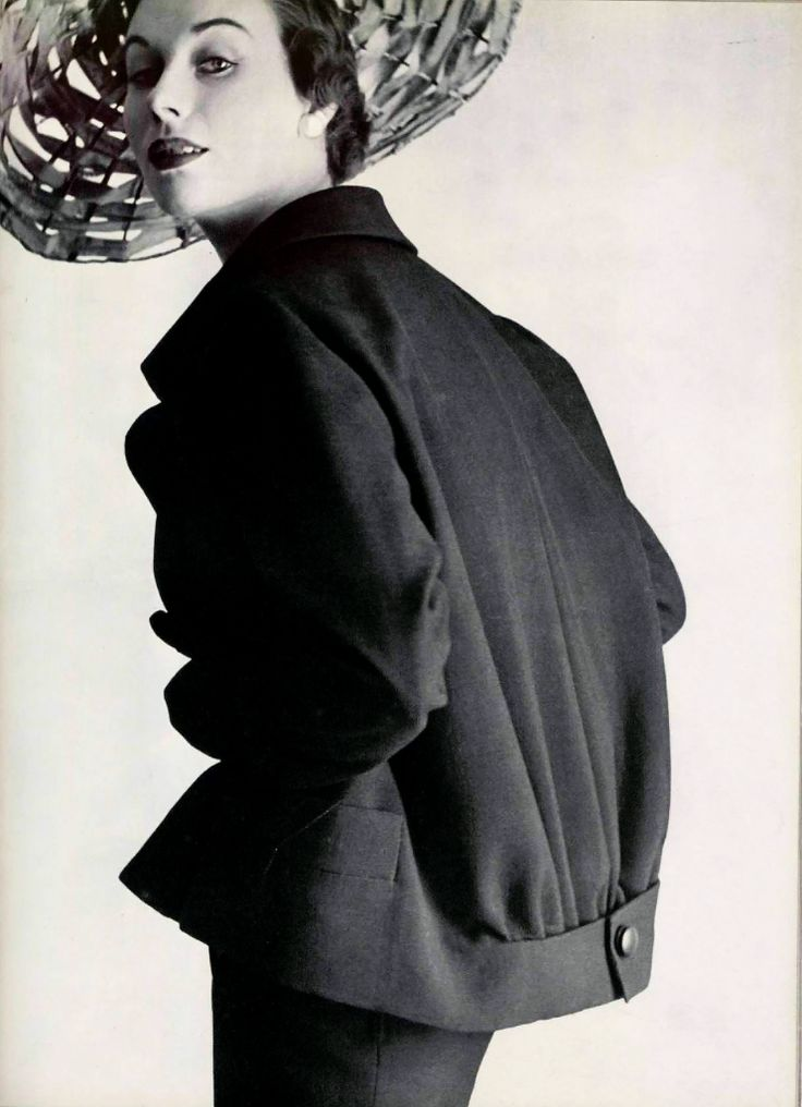 Model in long jacket by Christian Dior held tight near the hips by a martingal, photo Pottier, 1952
