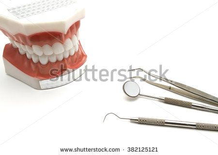 On the dental's table , there is a dentoform for treatment plan and some dental instruments.