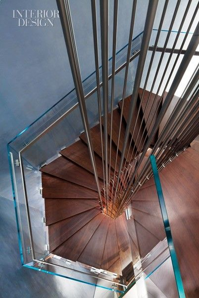 Interior Design Magazine: A three-storey staircase wraps around stainless steel rods at David Yurman's new uptown NYC flagship designed by Gabellini Sheppard. #InteriorDesignMagazine #Interiordesign #design #DavidYurman #NYC #Retail #GabelliniSheppard #staircase