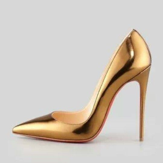 Gold Louboutin high heel pumps