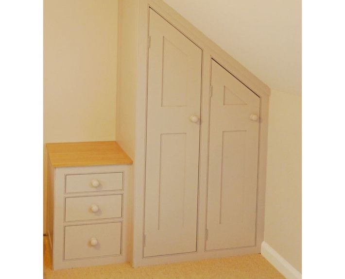 Slinky dink under the eaves wardrobes and bedside cupboard for an attic bedroom.  Could only be bespoke!