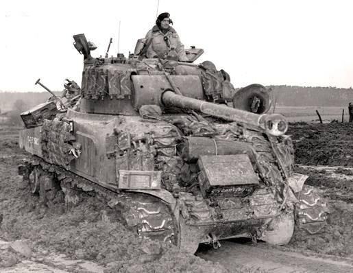 Well-camouflaged, Sherman tank of the Ontario Regiment advances on San Angelo, Italy, May 1944