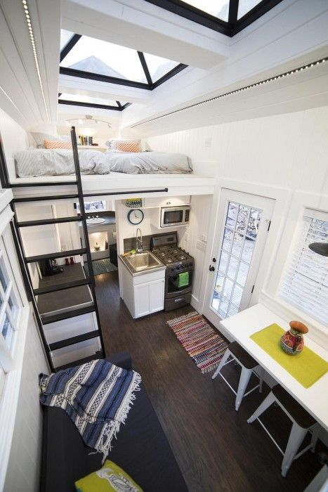 Every detail in this tiny house is just perfect…but that roof? Remarkable!