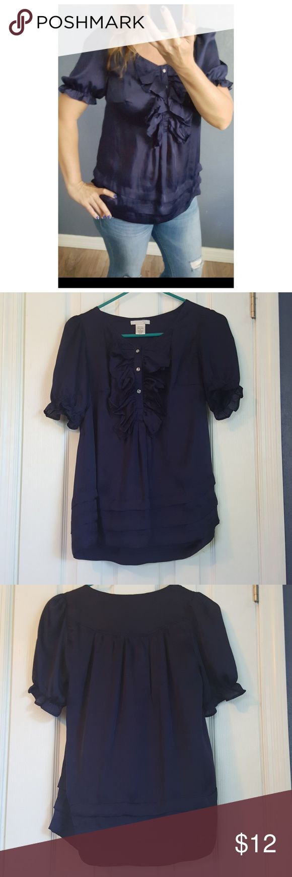 """Cute, Feminine Navy Career or Casual Top EUC This top is perfect for any season; great for casual or career. It's a very soft navy color,  light, cooling fabric 100% poly. It has ruffle, jewel button detail with puffy cap sleeves. Lots of darting,  layered look detail on bottom hem,  as well, to make it very flattering and feminine.  No tears stains or odors. Its a size small but could fit size 6-10. I'm 135# 5'4"""" for size reference. Please ask any questions or shoot me an offer! Funkadelic…"""