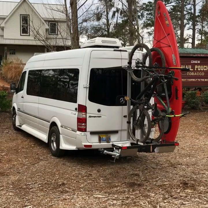 Hitch swing rack on van rack swings open so you have rear