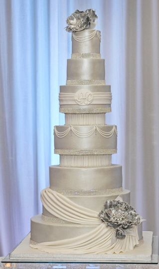 Round Wedding Cakes - Buttercream cake airbrushed with pearl dust.  Gumpaste flowers are painted in silver.  Go Buttercream!