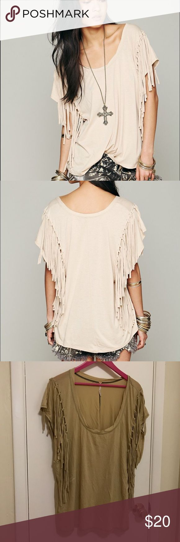 Free people tan fantasy fringe tee size large Super soft fantasy fringe free people tee shirt. Color is a nice tan, or sand color. Not as cream as brand stock picture shows. One small bleach stain on front, otherwise in good condition. See picture for details. Fringe mostly hides stain when worn. Size large. Fits like an oversized tee shirt. Perfect with jeans and booties. Cotton material. Free People Tops Tees - Short Sleeve