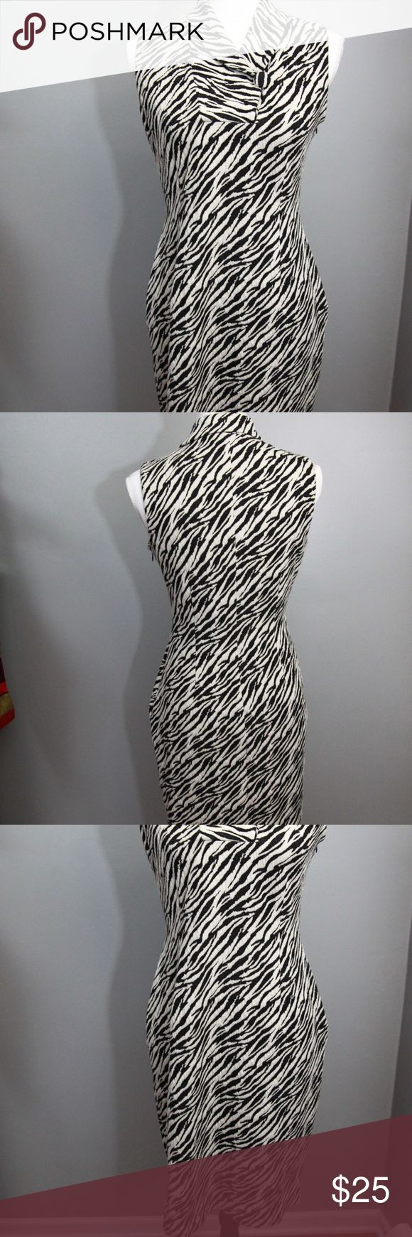 Calvin Klein Zebra Print Dress Sz 4 Calvin Klein black and beige zebra print sleeveless dress. Buttons at neckline but can be left open for a new look. Side zip. Polyester 84%, rayon 15%, spandex 1%, dry clean.  Measurements Bust 38 inches Length 40 inches down mid back  inventory 55-117 Calvin Klein Dresses