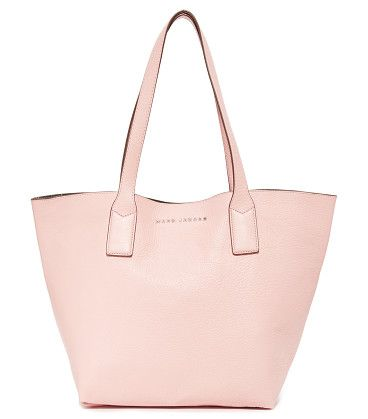 Marc Jacobs Wingman Tote by Marc Jacobs. A roomy Marc Jacobs tote in pebbled leather. A spring lock and ring gather the base. Leather lined interior with an o...