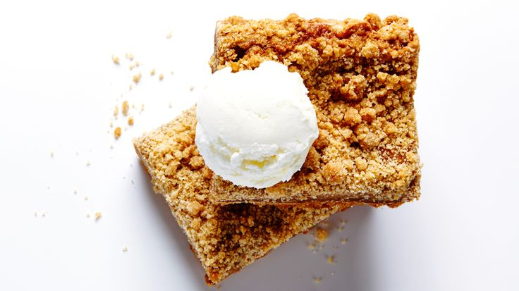 Start humming The Star-Spangled Banner because these easy and delicious Apple Pie Bars are going to have you pledging allegiance (to Bite Me More). A fresh take on the American classic dessert, these Apple Pie Bars, with their buttery graham crust, luscious apple toffee filling and crunchy streusel, are perfectly portable, personal pies.  How bout them apples?