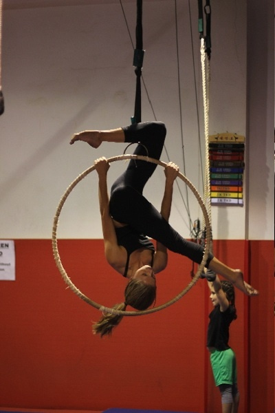 Good practice move for future tricks. Get into with pencil at top of hoop to hook knee