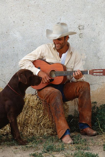 a cowboy & a dog... it just doesn't get any better.