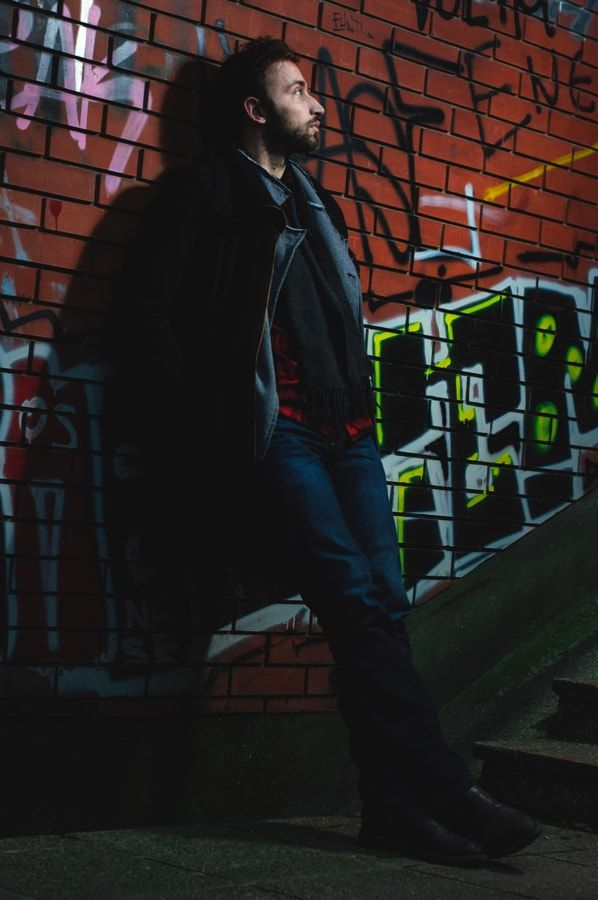 #portrait #man #male #model #posing #urban #modern #city #concrete #lifestyle #fashion #outfit #wear #concretejungle #beard #hairstyle #cigar #graffitti #culture #outdoors #light #flash #shadow #detail