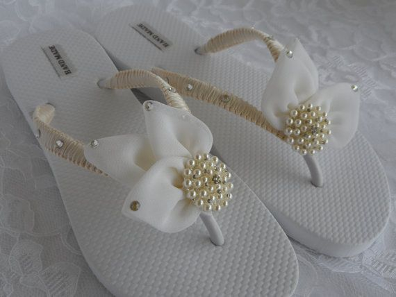 This gorgeous Bridal Flip Flops with Chiffon Leaf is the perfect gift for a wedding. These Flip Flops are hand made in Macrame wrapped and with exquisite Flat back Swarovski Crystal on side. Is adorned with 3 handmade Ivory Chiffon Leaf and embellished with beautiful Rhinestones Pearl in the center. I can do your flip flops in your wedding colors. Awesome for beach/ Summer weddings and as bridal party, flower girl & Mom gifts!! These flip flops are available in the following heel h...