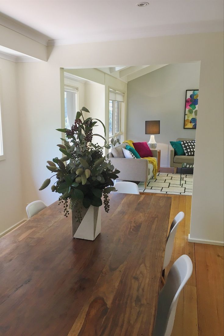 Open plan living and dining.  Property styled for sale by Leeder Interiors