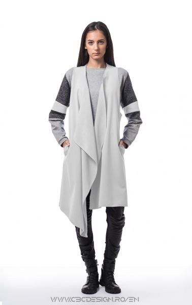 Oversized asymmetrical vest from grey softshell fabric, warm-keeeper and waterproof, with side pockets. It's a versatile item, it's loose fit allows it to be worn in multiple outfits through styling, either over tops or under jackets. it's neutral color transforms the Platinum Vest into a must-have item for layering