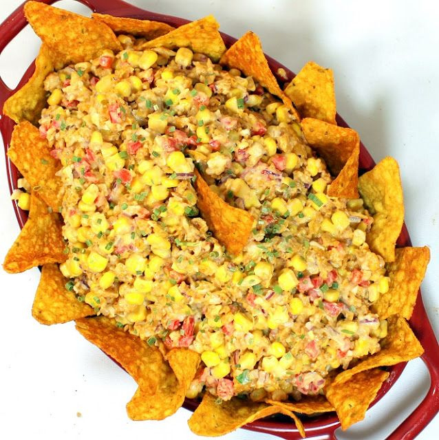 Doritos Taco Corn Salsa, Salad, or Side Dish - Interesting recipe including corn, cheddar, mayo, ranch dressing, bell pepper, & onion.  Three-fourths of a bag of taco-flavored Doritos is coarsely crushed & mixed in, with the remainder used as a garnish around the edge.  Served cold. Great game day recipe. #tailgating