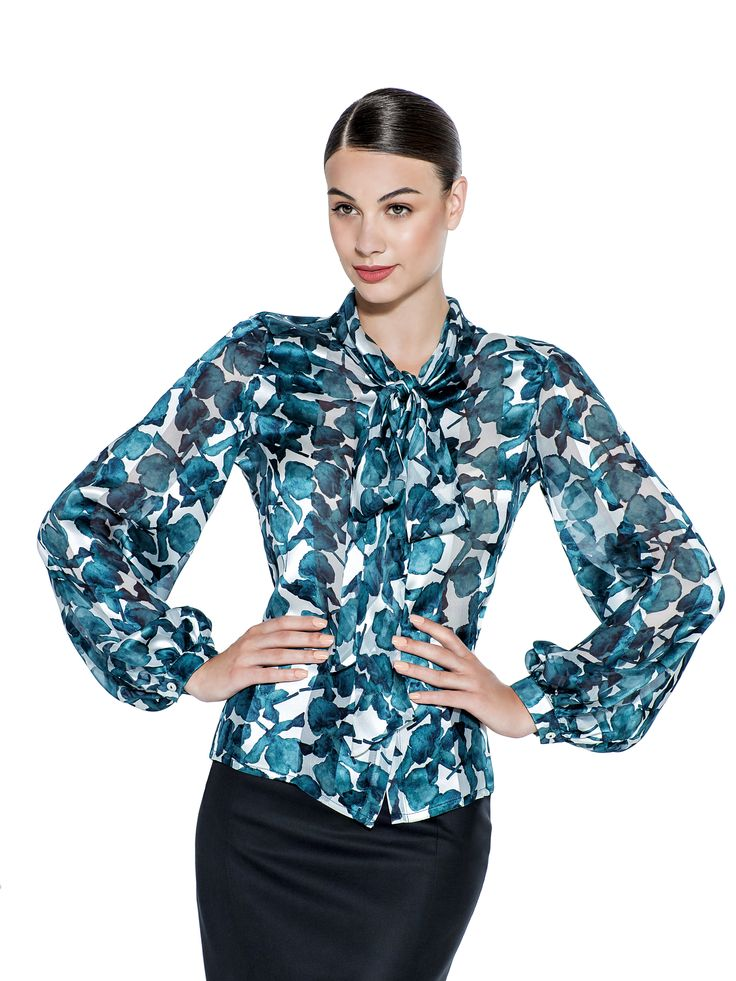 With bell cuffed sleeves and printed petrol flowers, this silk blouse will brighten up your 9 to 5. The hidden buttons and chic bow neckline create a finished look. Tuck into pencil skirt or tailored trousers alike, for instant elegant style. Fabric imported from Hong Kong: 100% Silk  Washcare: Dry clean MADE IN EUROPE