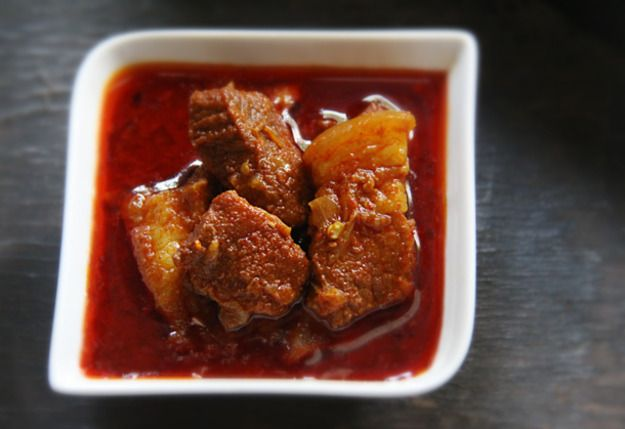 Spicy and piquant, Pork Vindaloo has pride of place on Sundays and days of feasting in Indian Catholic homes. Usually mopped up with soft white bread or drenched over fluffy white rice.