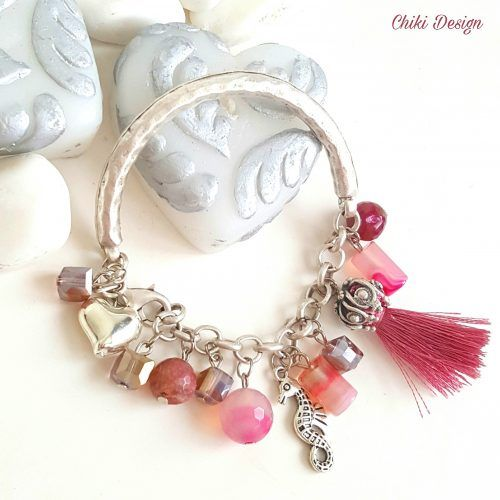 Handcrafted silver bracelet with 2016 cubic Swarovski Elements, pink tassel, pink quarts beads, Jade natural gemstone beads, and silver-plated seahorse charm. This bracelet is a handmade and unique addition to any jewelry collection, inspired by the latest trends. Chiki Design