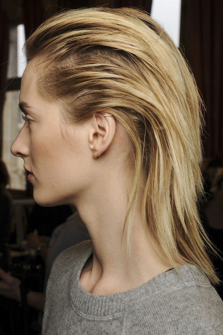 Backstage Hair: Autumn/Winter 2013-14 - Balmain: The hair was swept right to the nape of the neck, where it then hung in gentle waves down model's backs.