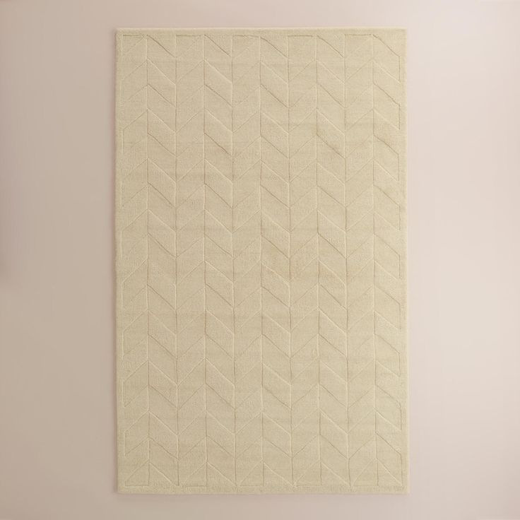 From World Market · Hand Tufted In An Ivory Hue, Our Exclusive Area Rug  Boasts A Hand Carved