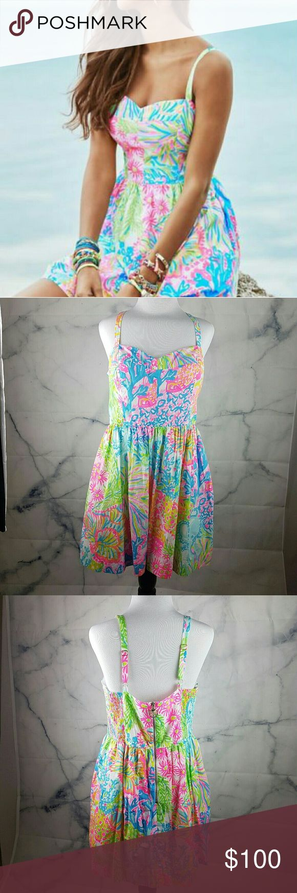 "Lilly Pulitzer Coral Sundress Size 12 This amazing & colorful sundress was gently worn and is in perfect condition. It has a 100% Cotton lining and the zipper has a cute shell detail! This dress is THE summer staple! Fabric: 100% cotton.  Length from straps to seam: 27"" Lilly Pulitzer Dresses Mini"