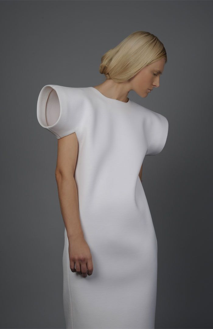 Extended sculptural sleeve detail, fashion minimalism - Tze Goh AW2010.